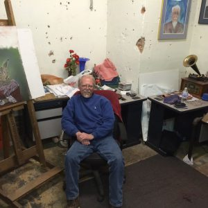 The artist in his native environment, nearly finished with Ellie. Ray Wollschleger, the neighbor a few streets over, works with pastel chalks in a studio in downtown Delaware.